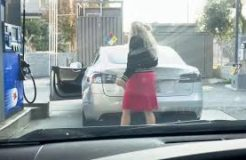 Blonde Woman Tries To Fill Up A Tesla Model S With Gas